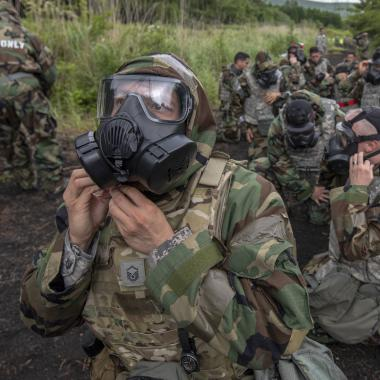 Airmen don their M50 Joint Service General Purpose Field Mask during Chemical, Biological, Radiological and Nuclear training(Photo: Yasuo Osakabe)